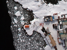 Residents of Palmer Station, Antarctica, used their bright red United States Antarctic Program parkas to send a ground-to-air greeting to scientists and flight crew aboard NASA's DC-8 flying science laboratory as it flew over the station during Operation Ice Bridge.
