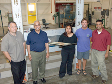 Progress is being made in the Distributed Aerodynamic Sensing and Processing, or DASP, toolbox project. The Aeroelastic Test Wing 2 test fixture that will take the project into the flight environment on an F-15B is seen early in the process in this photo that includes some of the team members. From left are David Voracek, Siva M. Mangalam, Claudia Herrera, Marty Brenner and Arun Mangalam.