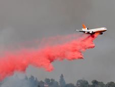 A tanker drops slurry on a fire, but Systems Technology was asked to assist in determining if other aircraft could serve as tankers.