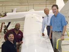 A fiber optic cable is the thickness of a human hair and cant be seen in the center of this wing, but the tiny fiber could have ramifications for every future aircraft and spacecraft. Team members include, from left, Anthony Nino Piazza, Allen Parker, William Ko and Lance Richards.