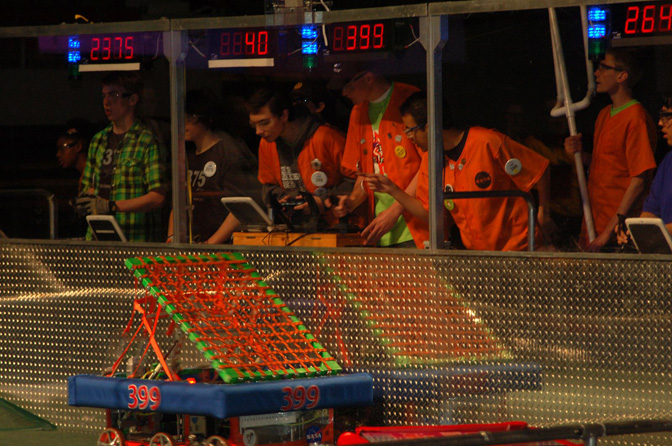 Lancaster High Eagle Robotics team members maneuver their machine during the FIRST Robotics regional competition in Phoenix March 13.