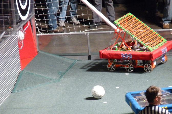 Lancaster High School's Eagle Robotics Team 399's The Wizard robot, competing as part of the red team alliance, punches a ball into the goal during the FIRST Robotics regional games in Phoenix March 13.
