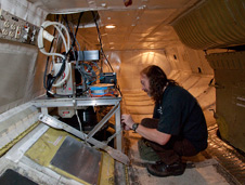 Goddard technician checks out the Laser Vegetation and Ice Imaging Sensor mounted in the belly of NASA's DC-8.