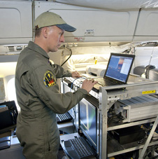 URS Corp. scientist checks out the Airborne Topographic Mapper mounted in NASA's DC-8.