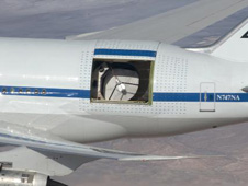 A German-built telescope is exposed during a flight of NASA's Stratospheric Observatory for Infrared Astronomy 747SP