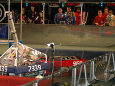 Antelope Valley High School Team number 2339's controllers maneuver their robot against another team's robot at the FIRST robotics regional competition in Long Beach March 20.