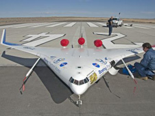 NASA Dryden engineer Gary Cosentino prepares the X-48B for flight.