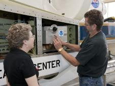 Technicians install NOAA's Ozone instrument on NASA's Global Hawk