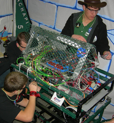Members of Tehachapi High School's Robotics Team perform adjustments to their robot at Las Vegas regionals.