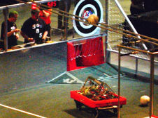 Tehachapi High School Robotics team members Brandon House and Taylor Wood drive their robot into scoring position at Las Vegas regionals.
