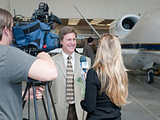 Time Warner Cable SoCal News' Cody Urban and Keli Moore interview NASA atmospheric physicist Paul Newman beside a NASA Global Hawk
