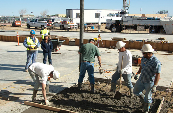 Construction workers pouring concrete during construction of Dryden's new Consolidated Information Technology Center.