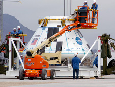 At the U.S. Army's White Sands Missile Range in New Mexico, technicians position the boilerplate crew module on the launch pad March 23 in preparation for the Pad Abort-1 flight test.