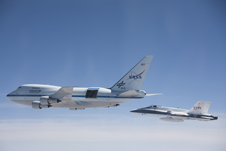 An F/A-18 aircraft monitors the flight of the Stratospheric Observatory for Infrared Astronomy as it successfully completes another test flight.