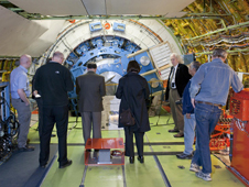 Media representatives get an opportunity to learn more about the NASA 747SP and its telescope, which is nestled in the rear fuselage of the aircraft.