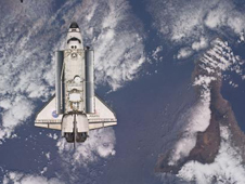 With Tenerife in the Canary Island chain visible at right, space shuttle Atlantis approaches the International Space Station during STS-132 rendezvous and docking operations.