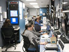 Engineers work inside NASA's mobile operations facility at the White Sands Missile Range.