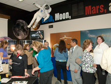 Visitors take note of a variety of displays and exhibits during an open house at NASA Dryden's visitor center in the AERO Institute in Palmdale.