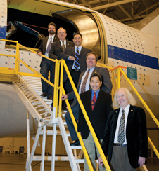 Stratospheric Observatory for Infrared Astronomy program officials representing NASA, the Universities Space Research Association and Deutsches SOFIA Institut line up on the access stairs to the open telescope cavity.