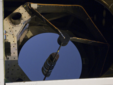 Faint specks of stars are reflected by the 98-inch (2.5-meter) primary mirror on NASA's Stratospheric Observatory for Infrared Astronomy during ground testing in May of the Faint Object Infrared Camera for the SOFIA Telescope.
