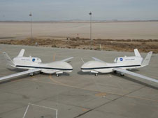 Two Global Hawks sitting on runway