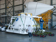 The Orion PA-1 test module is moved carefully into the space shuttle hangar, where Dryden crews will prepare it for another flight research mission.