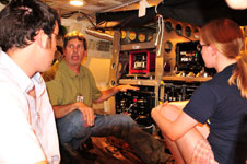 Jeff Dunwoody of the University of California at Santa Cruz explains the functions of the MASTER instrument mounted in the lower cargo hold of NASA's DC-8 airborne science laboratory to two SARP students.