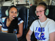 Josette Marrero (left) and Heather Sopher, both students at the University of California at Irvine, were all smiles during the students' data-collection flight.
