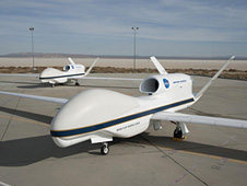 Two NASA Global Hawks parked