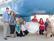 Teachers and project officials gathered under the UAVSAR pod mounted underneath the aircraft.