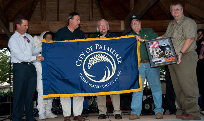 A Palmdale municipal flag that was flown on space shuttle Atlantis during the recent STS-132 shuttle mission was presented to officials of the City of Palmdale, Calif., at a brief ceremony July 29.
