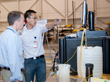 NASA's chief technology officer Bobby Braun (at left) is briefed by Dryden aerostructures engineer Patrick Chan on components of the Dryden-developed Fiber Optic Strain Sensing technology during Braun's visit to NASA Dryden on Aug. 12, 2010. (NASA photo / Carla Thomas)