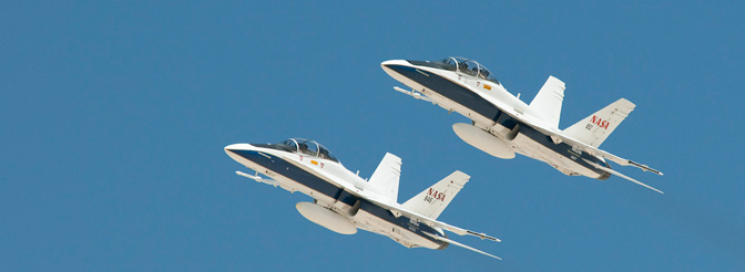NASA F/A-18Bs fly the sonic boom demonstrations flyover.
