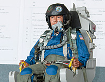 Student is seated in a practice ejection seat.
