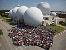NASA personnel gathered as a team before sensor domes