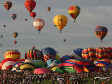 A wave of hot air balloons lifts off at the Albuquerque, N.M., International Balloon Fiesta.