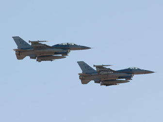 A pair of F-16s from nearby Edwards Air Force Base kicked off the 2010 Antelope Valley Veterans Day Parade with a thunderous low-level formation flyover.