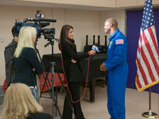 Time Warner Cable TV News reporter Suzi Theodory interviews NASA education chief and former astronaut Leland Melvin following his presentation to students at Shadow Hills Intermediate School in Palmdale Dec. 8, 2010.