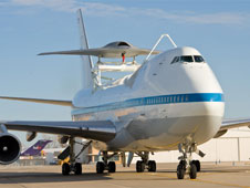 Boeing's Phantom Ray unmanned aircraft system technology demonstrator became a paying piggyback passenger on NASA's Shuttle Carrier Aircraft for its ferry flight from St. Louis to Edwards