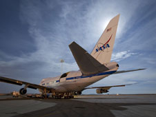 The Stratospheric Observatory for Infrared Astronomy NASA 747SP sits beneath a full moon during nighttime telescope operations at NASA's Dryden Aircraft Operations Facility, Palmdale, Calif.