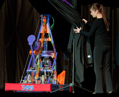 Theresa Bastian of the Lancaster High Eagle Robotics team unveils