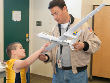 Pilot outlines features of the Ikhana / Predator B remotely operated aircraft to student.