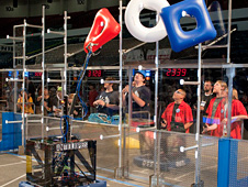 Antelope Valley High's robot hangs the last of three inflated shapes to form the FIRST logo on a peg.