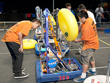 Lancaster High's Eagle Robotics team make lasts-minute adjustments to their robot.