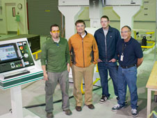The Experimental Fabrication Facility recently began operations with a five-axis router that expands the facility's capabilities. From left in front of the router are Jeromy Robbins, Aaron Pahs, Eric Nisbet and Ed Swan.