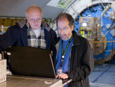 GREAT principal investigator Rolf Guesten, left, and GREAT team member Urs Graf, senior scientist at the University of Cologne, Germany, discuss preparations for SOFIA flights to be made with the instrument.