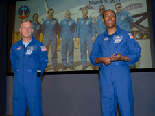 Space Shuttle Discovery Commander Steve Lindsey, left, and mission specialist Alvin Drew share highlights of the orbiter's final mission with Dryden employees April 26.