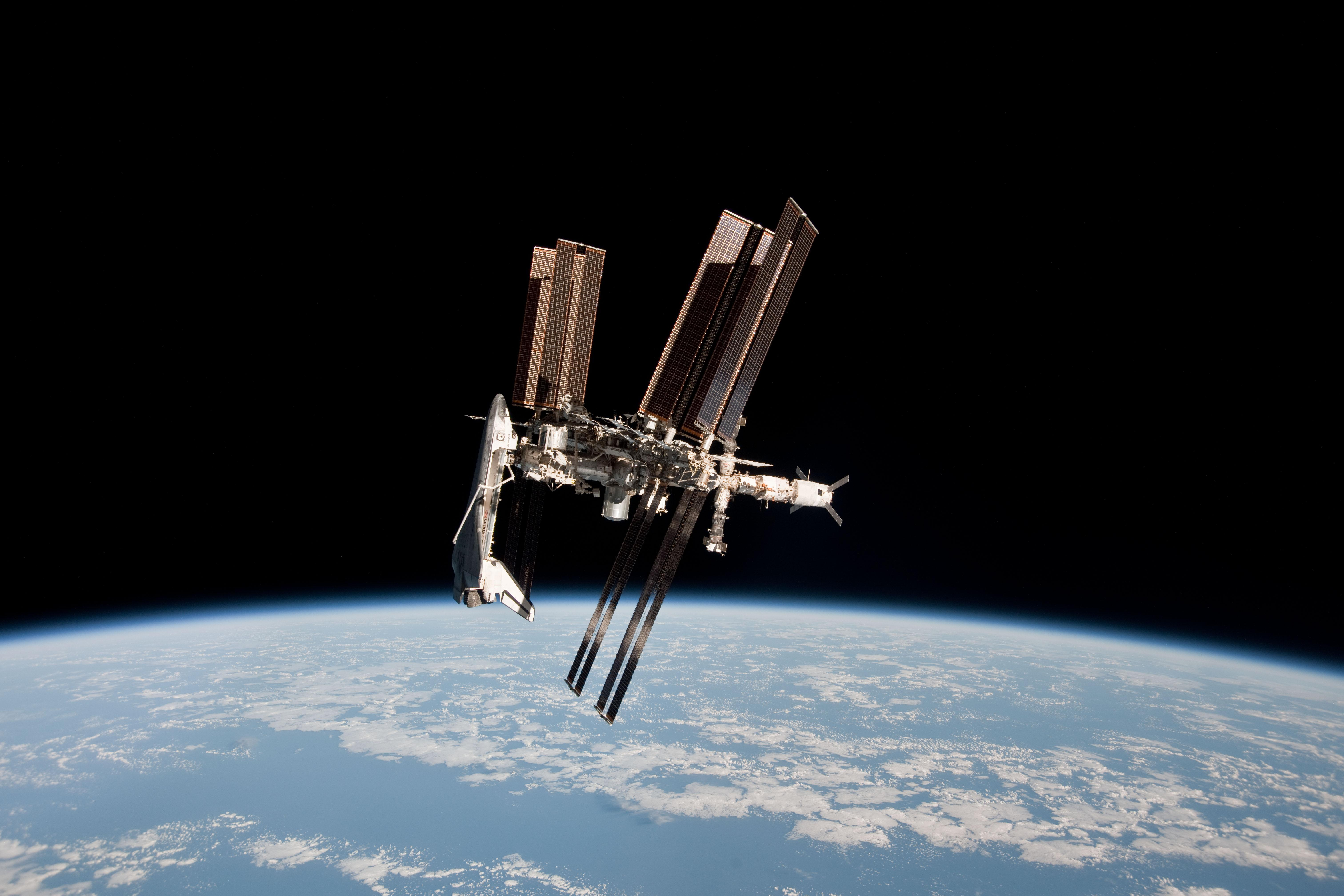 Portrait of shuttle and station nasa for When was the international space station built