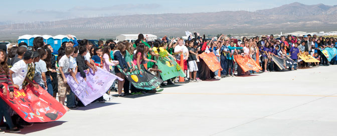 Students gathered for the Intermediate Rocket Challenge display their team banners on the Mojave Air and Space Port flight line.