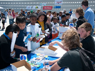 The NASA education outreach table staffed by employees of the AERO Institute in Palmdale was a popular stopping point for students participating in the rocket challenge.